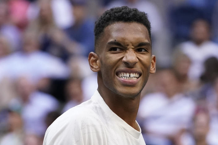 Felix Auger-Aliassime, of Canada, reacts after losing a point to Daniil Medvedev, of Russia, during the semifinals of the US Open tennis championships, Friday, Sept. 10, 2021, in New York. (AP Photo/John Minchillo)