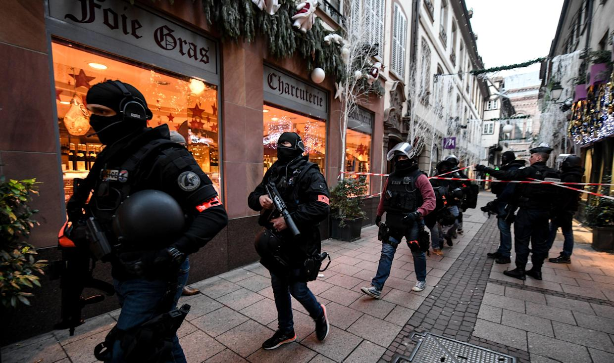 Members of the French National Police BRI (Research and Intervention Brigade) during their search for a suspect following a deadly shooting that took place at a Christmas market in Strasbourg, France, Dec. 12, 2018. (Photo: Patrick Seeger/EPA-EFE/REX/Shutterstock)