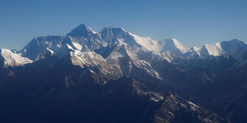 Mount Everest, the world highest peak, and other peaks of the Himalayan range are seen through an aircraft window during a mountain flight from Kathmandu in January 2020.
