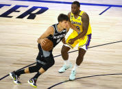 Sacramento Kings' Bogdan Bogdanovic (8) drives against Los Angeles Lakers' Dion Waiters (18) during the second quarter of an NBA basketball game Thursday, Aug. 13, 2020, in Lake Buena Vista, Fla. (Kevin C. Cox/Pool Photo via AP)