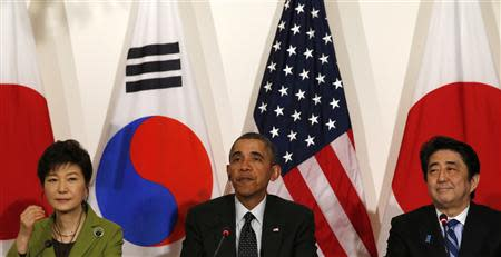 Obama holds a tri-lateral meeting with Park and Abe after the Nuclear Security Summit in The Hague