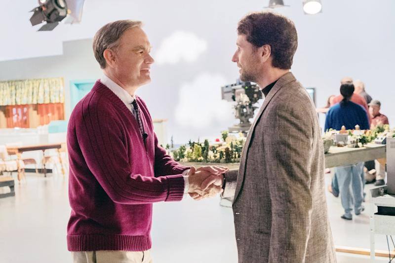 A BEAUTIFUL DAY IN THE NEIGHBORHOOD, from left: Tom Hanks (as Mr. Rogers), Matthews Rhys, 2019. ph: Lacey Terrell / TriStar / Courtesy Everett Collection