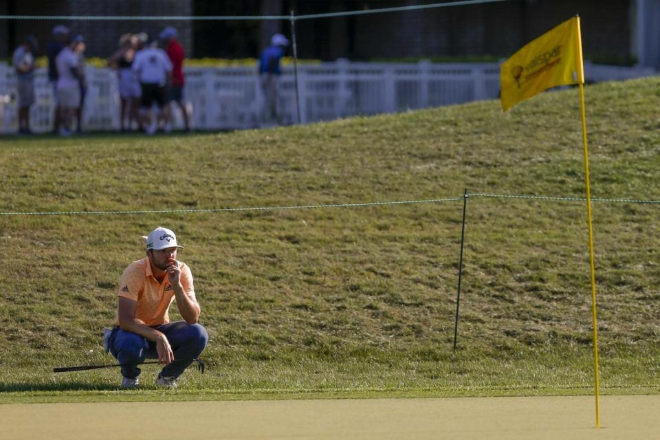 Sam Burns observes the green at the 15th hole during the PGA Valspar Championship golf tournament in Palm Harbor, Fla., Friday, April 30, 2021. (Ivy Ceballo/Tampa Bay Times via AP)