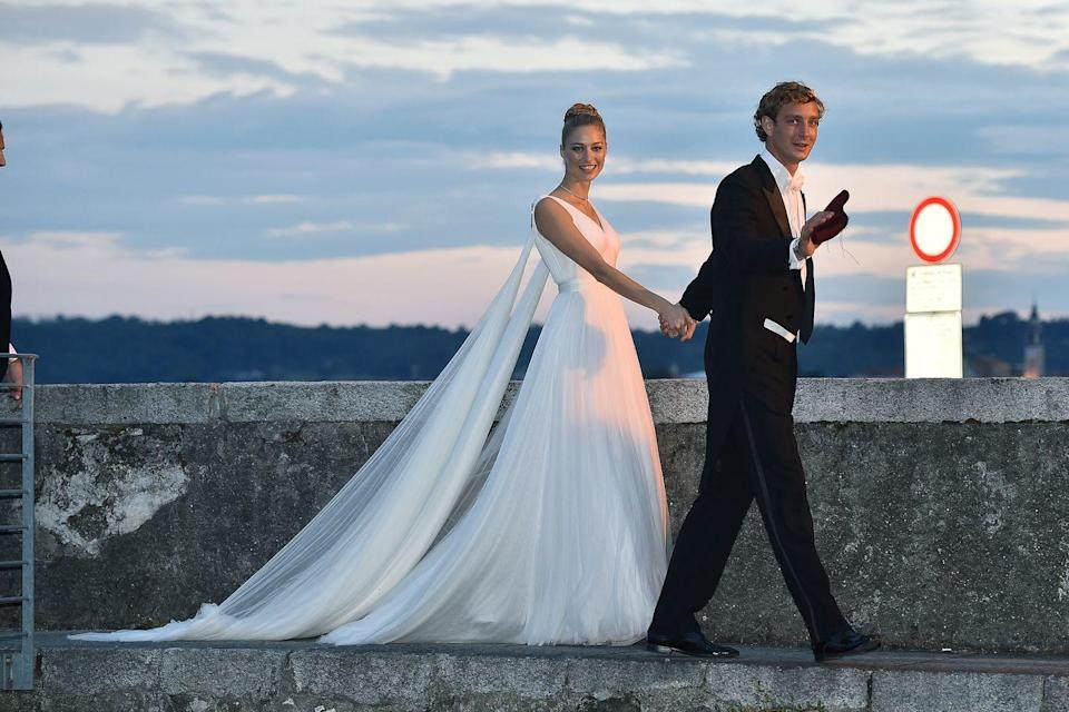 <p>Italian aristocrat, Beatrice Borromeo, wore five dresses for her wedding(s) to Princess Caroline of Monaco's son Pierre Casiraghi in 2015. Our favorite was her custom Giorgio Armani Privé gown, featuring a trailing cape and sweeping train, which she wore to their second reception on her family's private Italian island. </p>