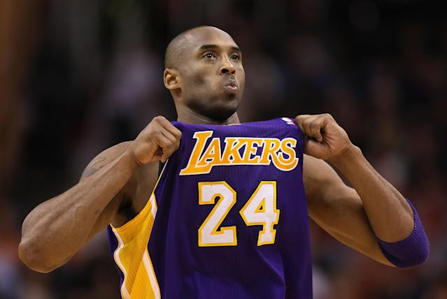 PHOENIX, AZ - FEBRUARY 19: Kobe Bryant #24 of the Los Angeles Lakers adjusts his jersey during the NBA game against the Phoenix Suns at US Airways Center on February 19, 2012 in Phoenix, Arizona. The Suns defeated the Lakers 102-90. NOTE TO USER: User expressly acknowledges and agrees that, by downloading and or using this photograph, User is consenting to the terms and conditions of the Getty Images License Agreement. (Photo by Christian Petersen/Getty Images)