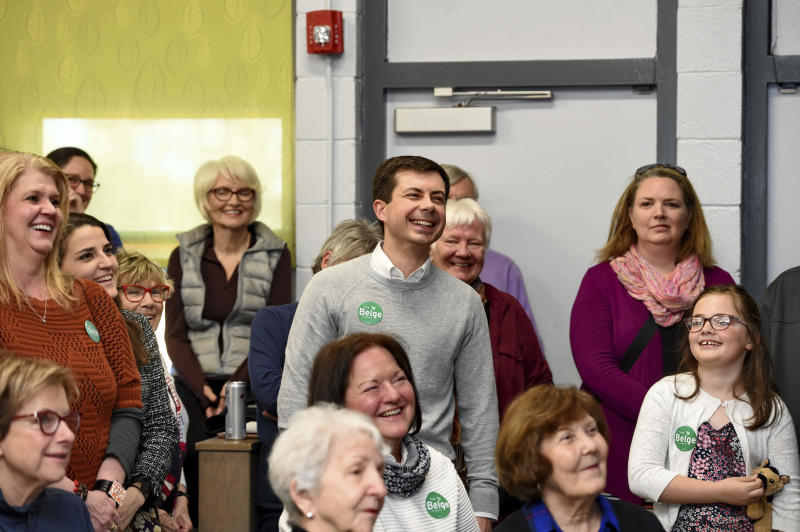 In this March 23, 2019, photo, South Bend Mayor Pete Buttigieg laughs before he speaks to a crowd about his presidential run during the Democratic monthly breakfast at the Circle of Friends Community Center in Greenville, S.C. Buttigieg was the longest of long shots when he announced a presidential exploratory committee in January. But now the underdog bid is gaining momentum, and Buttigieg can feel it. (AP Photo/Richard Shiro)