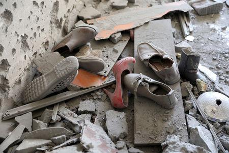 Shoes are pictured in a house damaged by shelling during the fighting between the eastern forces and internationally recognized government is pictured in Abu Salim in Tripoli, Libya April 15, 2019. REUTERS/Hani Amara