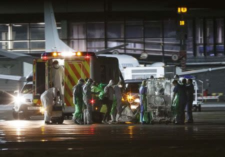 An Ebola patient is put on a Hercules transport plane at Glasgow Airport