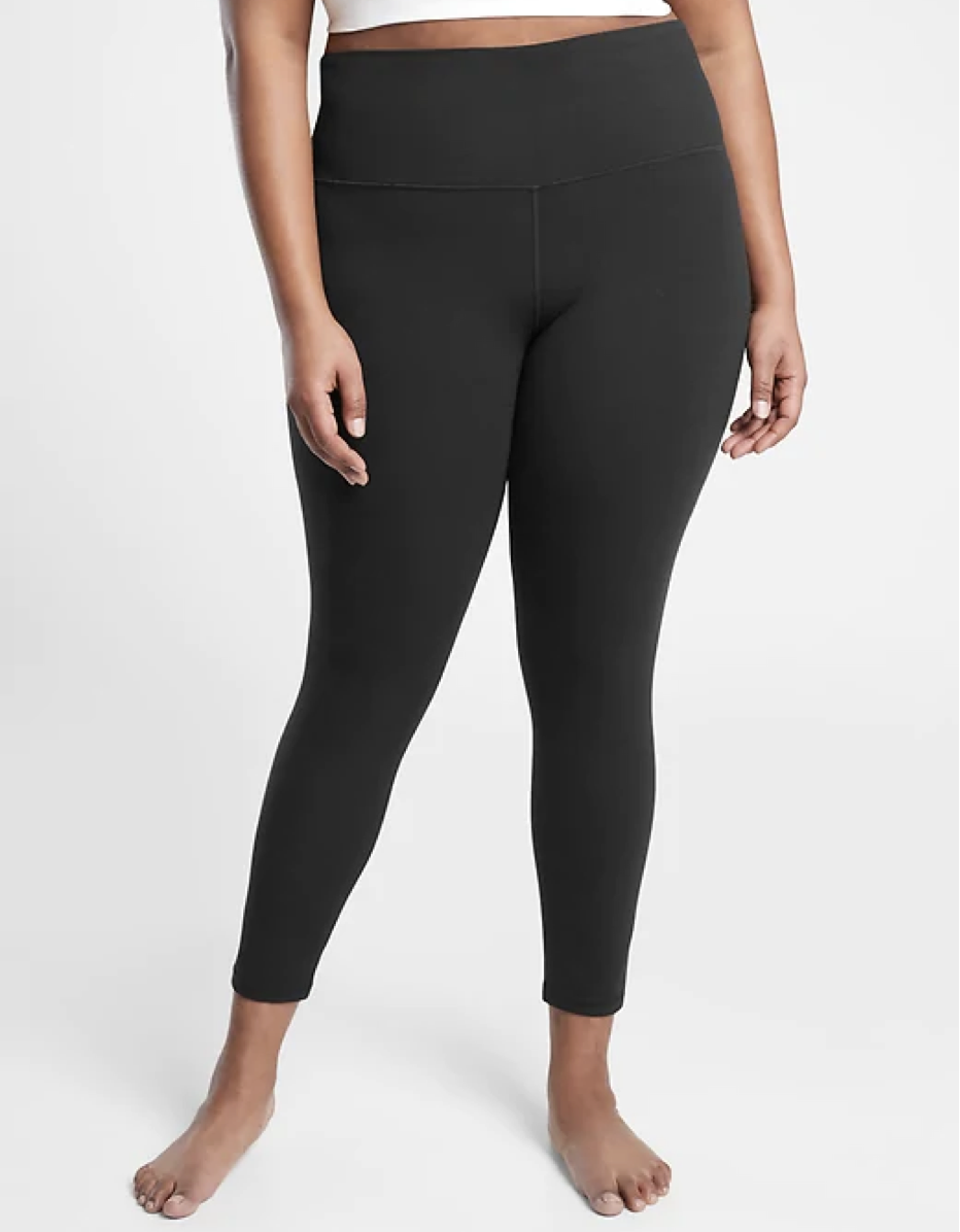"""These are the leggings you want to have on if you're weightlifting. The ultra-high rise fit stays firm—even while doing squats—and the Powervita fabric is soft, comfortable, and supportive. $89, Athleta. <a href=""""https://athleta.gap.com/browse/product.do?pid=502359002&vid=1#pdp-page-content"""" rel=""""nofollow noopener"""" target=""""_blank"""" data-ylk=""""slk:Get it now!"""" class=""""link rapid-noclick-resp"""">Get it now!</a>"""