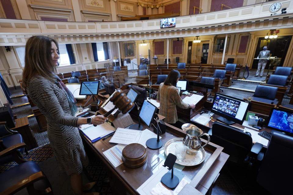 House speaker Delegate Eileen Filler-Corn, D-Fairfax, gavels in the session to an empty Virginia House of Delegates chamber after a Zoom Legislative session at the Capitol in Richmond, Va., Wednesday, Feb. 10, 2021. / Credit: Steve Helber / AP