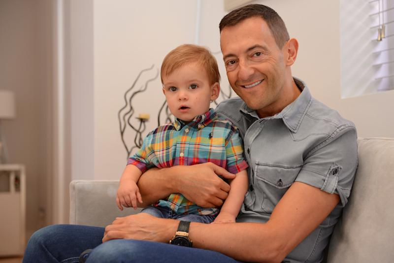 This July 2013 photo provided by the family shows Simon Taylor and his son, Cal. The 50-year-old Briton had a son via a surrogate birth in Arkansas in 2012, and is now working on arrangements to have a second child. Taylor, a self-employed businessman, describes himself as an admirer of America who never would have considered any other venue for the process. In an email, Taylor said he had extensive discussions with family and friends about his decision, with the upshot being strong support once those close to him realized how serious he was. (AP Photo/Simon Taylor)