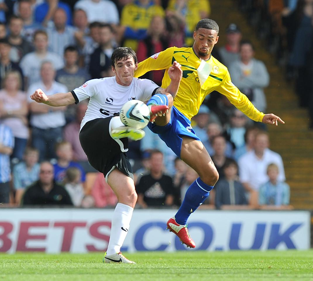 Coventry City's Jordan Clarke (right) and Port Vale's Louis Dodds (left) battle for the ball during the Sky Bet League One match at Vale Park, Stoke.