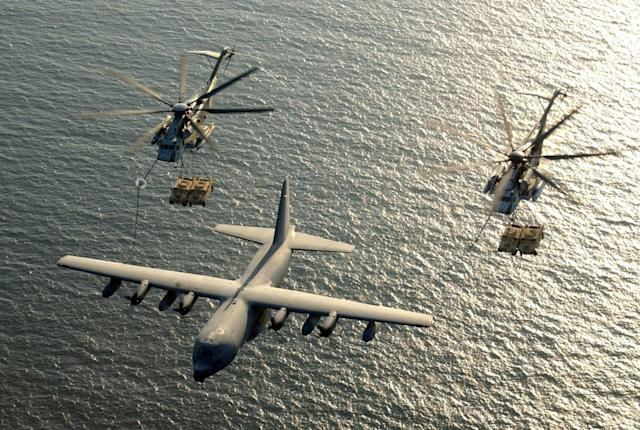 <p>Two U.S. Marine Corps CH-53E Super Stallion helicopters receive fuel from a KC-130 Hercules over the Gulf of Aden January 1, 2003. (Photo: U.S. Marine Corps/Cpl. Paula M. Fitzgerald/Handout via Reuters) </p>