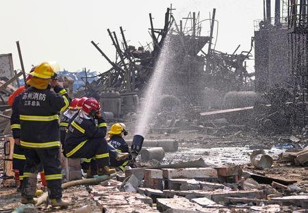 Firefighters work on the rubble of a pesticide plant owned by Tianjiayi Chemical following an explosion in Xiangshui county, Yancheng, Jiangsu province, China March 23, 2019. REUTERS/Aly Song
