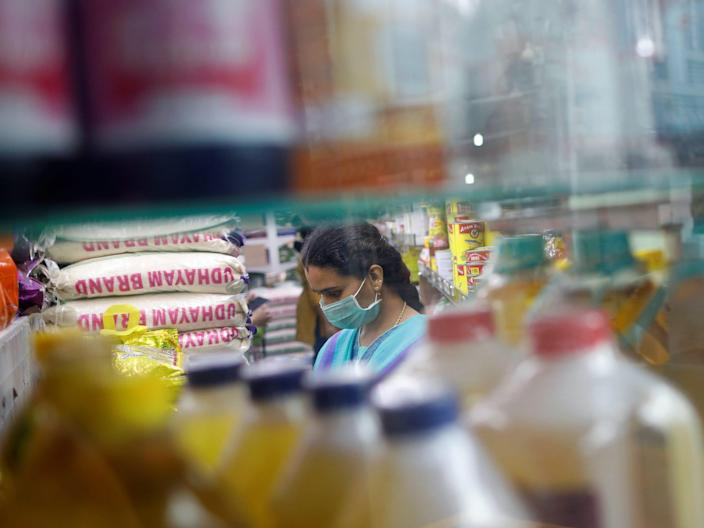 A woman wears a face mask at a shop in Little India district, as the spread of coronavirus disease (COVID-19) continues, in Singapore, April 2, 2020.