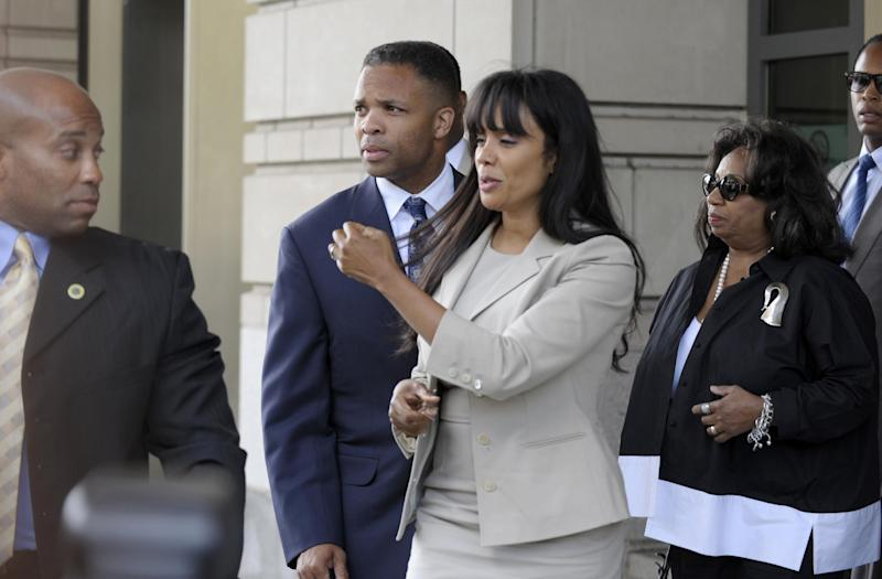 Former Illinois Rep. Jesse Jackson Jr., and his wife Sandra, leaves federal court in Washington, Wednesday, Aug. 14, 2013. Jackson was sentenced to two and a half years in prison Wednesday after pleading guilty to scheming to spend $750,000 in campaign funds on TV's, restaurant dinners, an expensive watch and other costly personal items. His wife received a sentence of one year. (AP Photo/Susan Walsh)