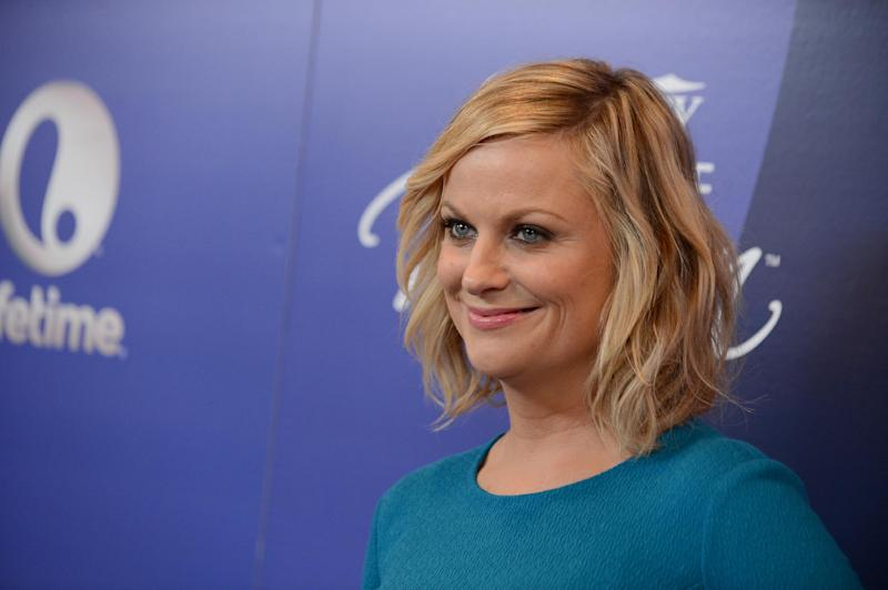 Actress Amy Poehler arrives at Variety's 5th Annual Power of Women event at the Beverly Wilshire Hotel on Friday, Oct. 4, 2013, in Beverly Hills, Calif. (Photo by Jordan Strauss/Invision/AP)