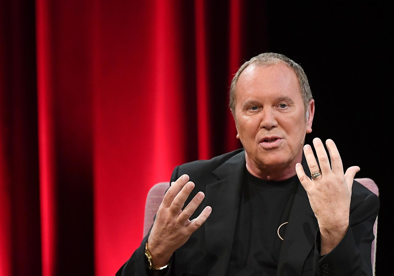 "Fashion designer Michael Kors speaks during ""The Atelier with Alina Cho: series"" event at NY's MET museum."