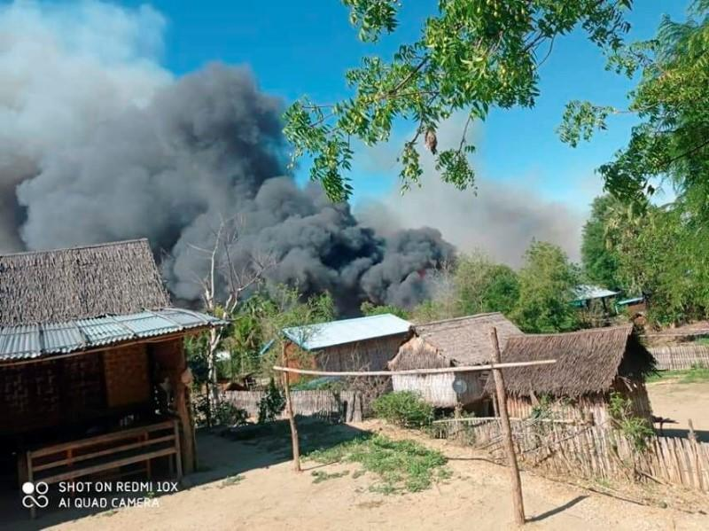 A view shows smoke from the fire in Kin Ma Village