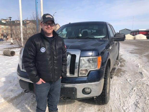 Tony Devlin of Inuvik ordered a custom-made vehicle from Whitehorse. He'd like to be able to go pick it up, without having to isolate on both sides of the border. (Mackenzie Scott/CBC - image credit)