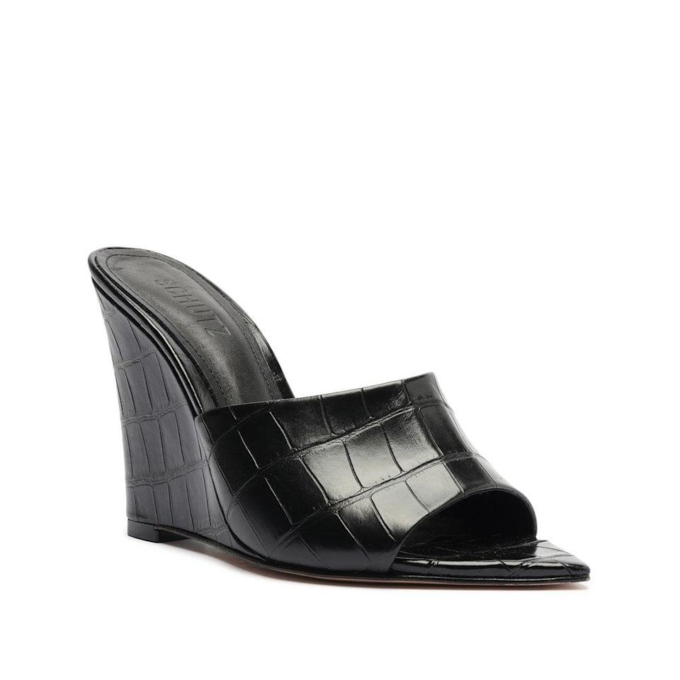 <p>Fall weddings call for this <span>Schutz Luci Crocodile-Embossed Leather Sandal</span> ($118). It also comes in green and pink if you want something a bit more fun and colorful.</p>