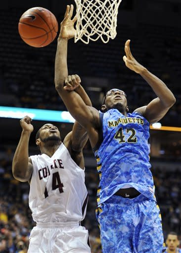 Colgate's Chad Johnson (14) and Marquette's Chris Otule (42) fight for the rebound during the first half of an NCAA college basketball game, Sunday, Nov. 11, 2012, in Milwaukee. (AP Photo/Jim Prisching)