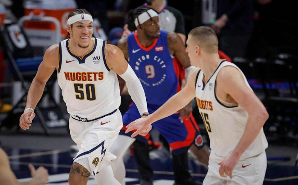 Denver Nuggets forward Aaron Gordon (50) smiles as he runs back up the court with center Nikola Jokic (15) in the third quarter of an NBA basketball game against the Detroit Pistons in Denver, Tuesday, April 6, 2021. (AP Photo/Joe Mahoney) ORG XMIT: COJM109