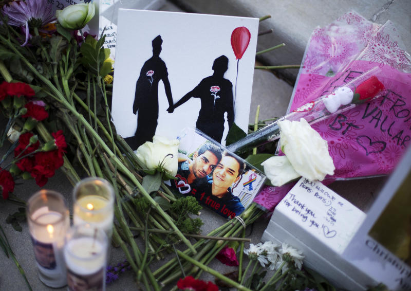 A makeshift memorial to Christopher Andrew Leinonen (R) and his boyfriend Juan Ramon Guerrero (L) on June 19, 2019. They were both killed in the Pulse nightclub mass shooting in Orlando.   David Goldman—AP