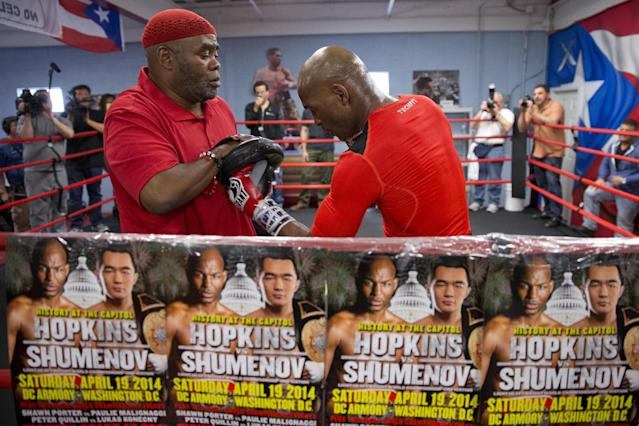 In this April 10, 2014 photo, IBF light heavyweight boxing champion Bernard Hopkins, right, works with trainer Naazim Richardson during a media workout in Philadelphia. Hopkins will attempt to become the oldest fighter in boxing history to unify world titles when he opposes WBA champion Beibut Shumenov April 19th at the DC Armory. (AP Photo/Matt Rourke)