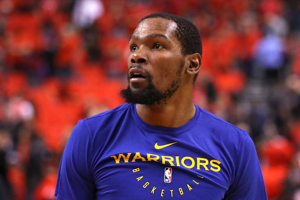 Kevin Durant appears to be making the most of his rehab while enjoying summer in California. (Getty)