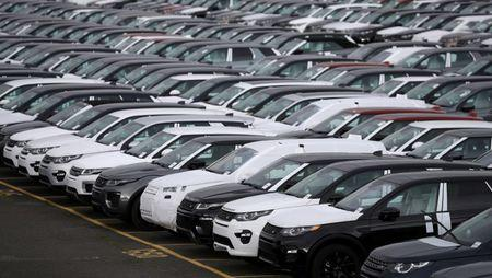 FILE PHOTO: New Land Rover cars are seen in a parking lot at the Jaguar Land Rover plant at Halewood in Liverpool, northern England.