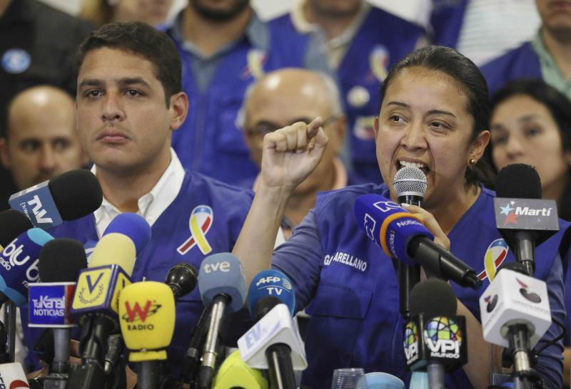 "FILE - In this Feb. 21, 2019 file photo, Venezuelan exiled lawmaker Gaby Arellano speaks to the media during a press conference in Cucuta, Colombia. ""Exile feels isolating, but we've been able to reinvent ourselves,"" said exiled lawmaker turned activist Arellano, who is playing a key role in collecting humanitarian aid. (AP Photo/Fernando Vergara, File)"