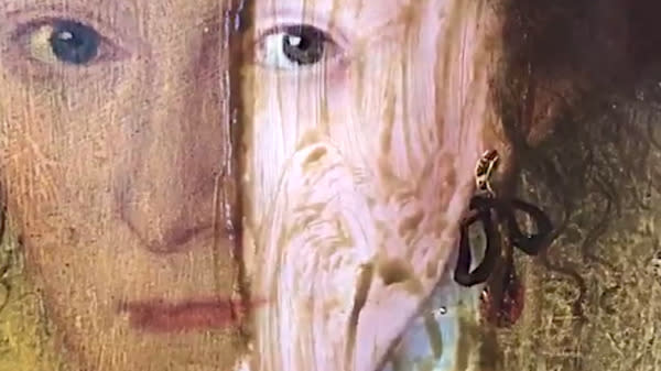 Centuries-old varnish disappears from an oil painting in a matter of minutes in two videos of a restoration that are going viral.