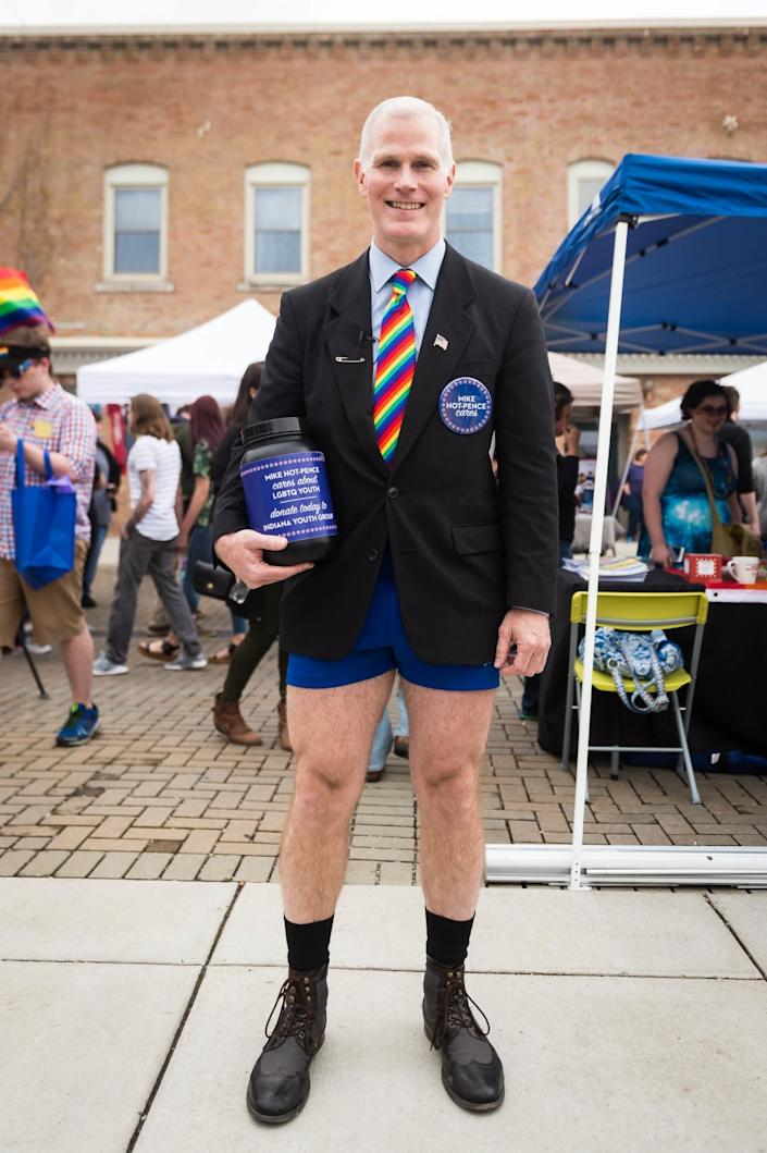 "Glen Pannell, a Mike Pence lookalike, wears hot pants with a jacket and tie while acting as ""Mike Hot-Pence."""