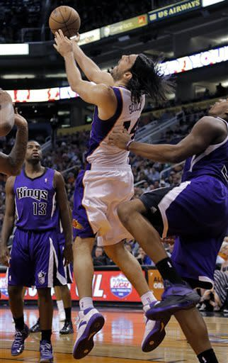 Phoenix Suns' Luis Scola, of Argentina, is fouled by Sacramento Kings' John Thompson during the second half of an NBA basketball game, Thursday, March 28, 2013, in Phoenix. (AP Photo/Matt York)
