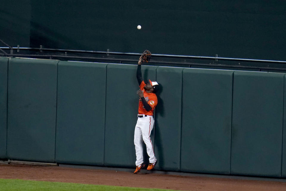 Baltimore Orioles center fielder Cedric Mullins goes up to make a warning track catch on a ball hit by Boston Red Sox's Enrique Hernandez during the fifth inning of a baseball game, Saturday, April 10, 2021, in Baltimore. (AP Photo/Julio Cortez)