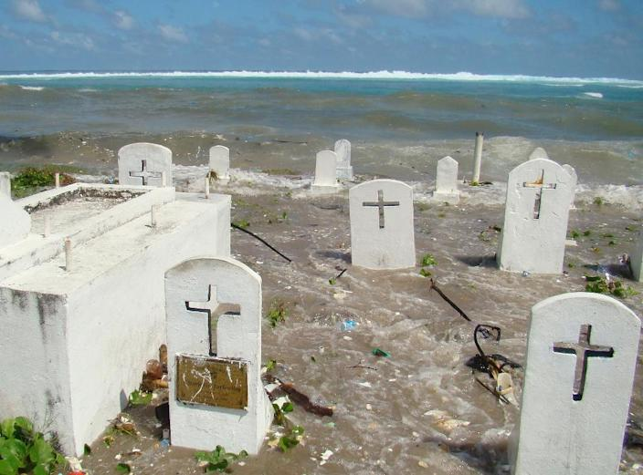 A cemetery in Majuro Atoll is flooded during high tide in the low-lying Marshall Islands, a Pacific atoll chain that sits barely a metre above sea level (AFP Photo/GIFF JOHNSON)