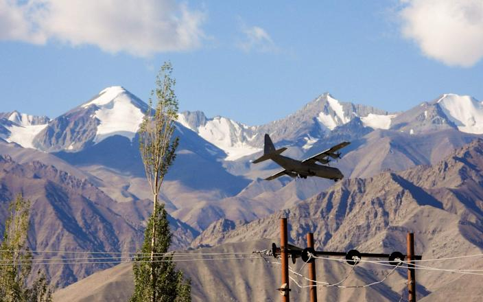 An Indian Air Force Hercules military transport plane prepares to land at an airbase in Leh