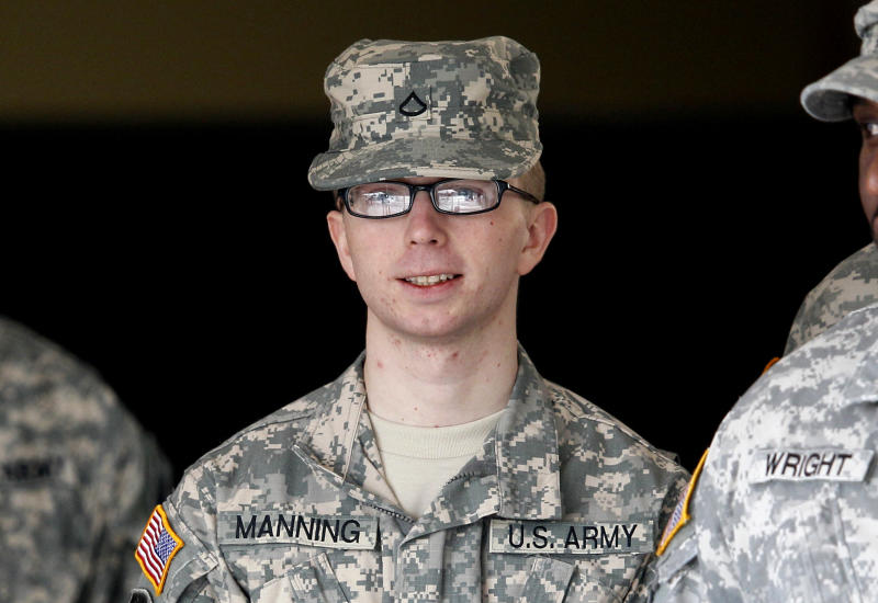In this photo taken Dec. 22, 2011, Army Pfc. Bradley Manning is escorted from a courthouse in Fort Meade, Md. An Army officer is recommending a general court-martial for Manning, a low-ranking intelligence analyst charged in the biggest leak of classified information in U.S. history.  (AP Photo/Patrick Semansky)