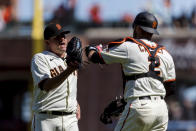 San Francisco Giants relief pitcher Jake McGee, left, and catcher Curt Casali celebrate after the Giants defeated the Texas Rangers 4-2 in a baseball game in San Francisco, Tuesday, May 11, 2021. (AP Photo/John Hefti)
