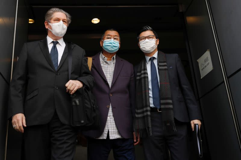 Media mogul and Apple Daily founder Jimmy Lai Chee-ying (C) leaves from a police station after being arrested for illegal assembly during the anti-government protests in Hong Kong