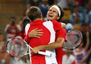BEIJING - AUGUST 16: Roger Federer (right) and Stanislas Wawrinka of Switzerland celebrate after defeating Thomas Johansson and Simon Aspelin of Sweden during the men's doubles gold medal tennis match at the Olympic Green Tennis Center on Day 8 of the Beijing 2008 Olympic Games on August 16, 2008 in Beijing, China. (Photo by Clive Brunskill/Getty Images)
