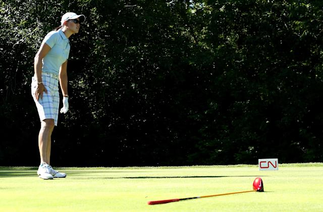 EDMONTON, AB - AUGUST 22: Michelle Wie watches her tee shot after dropping her club on the fifth hole during the CN Canadian Women's Open at Royal Mayfair Golf Club on August 22, 2013 in Edmonton, Alberta, Canada. (Photo by Stephen Dunn/Getty Images)