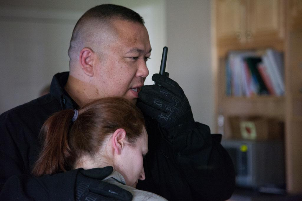 Berryville, VA - Jay Blevins holds his wife, Holly Blevins as he calls for backup.