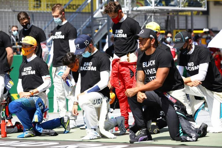 Lewis Hamilton and some drivers took a knee prior to the season-opening Austrian Grand Prix on July 5 (AFP Photo/Mark Thompson)