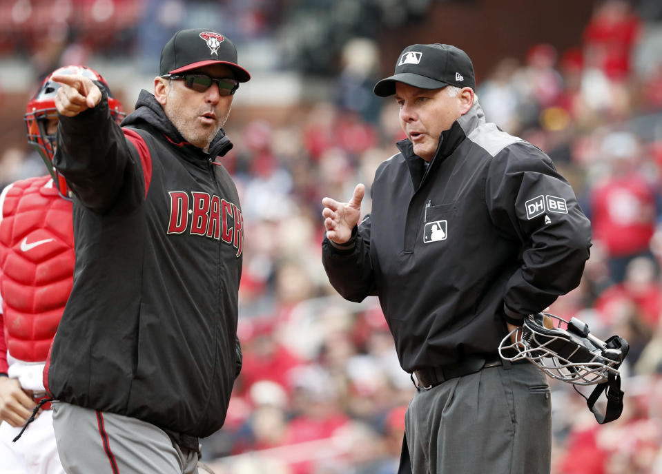 Arizona Diamondbacks manager Torey Lovullo, left, argues with home plate umpire Tim Timmons after being ejected by Timmons during the second inning of a baseball game against the St. Louis Cardinals Sunday, April 8, 2018, in St. Louis. (AP Photo/Jeff Roberson)