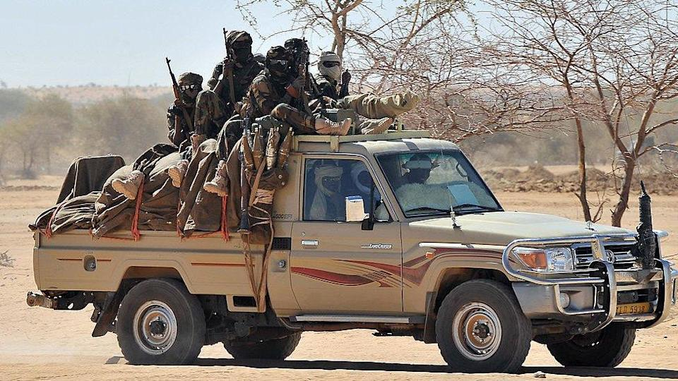 Soldiers from the Chadian army are driven in a pick-up near Iriba northern Chad -March 2009