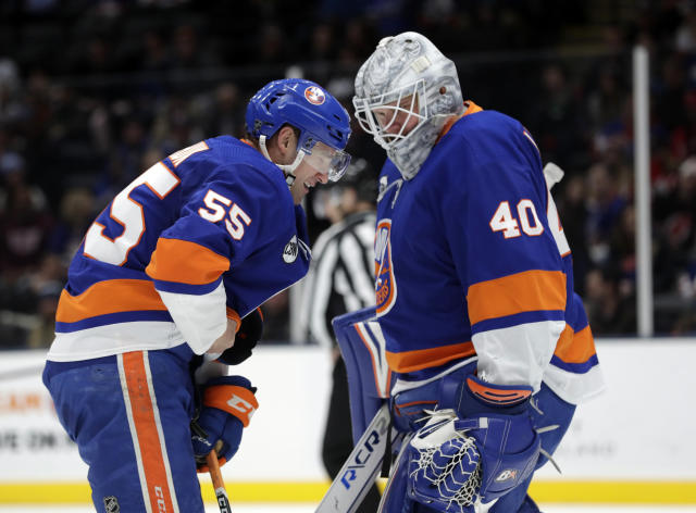 New York Islanders goaltender Robin Lehner (40) checks on teammate Johnny Boychuk (55) after Boychuck was hurt during the first period of an NHL hockey game against the New Jersey Devils, Thursday, Jan. 17, 2019, in Uniondale, N.Y. (AP Photo/Frank Franklin II)