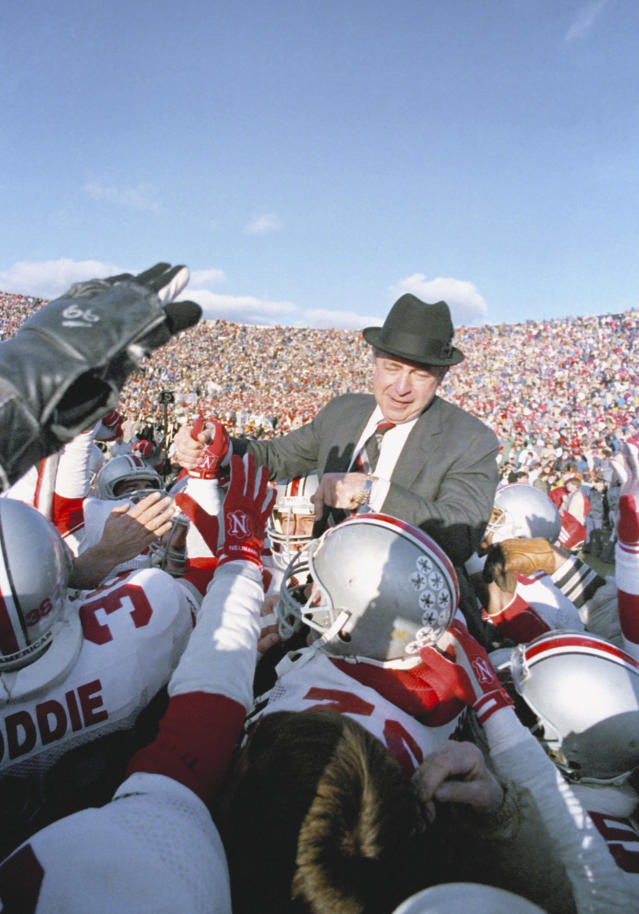 FILE - In this Nov. 21, 1987, file photo, Ohio State football coach Earle Bruce is carried by his players after the Buckeyes beat Michigan 23-20 in Ann Arbor, Mich. Bruce died in Columbus, Ohio at the age of 87, according to a statement released by his daughters through Ohio State on Friday. Hed been suffering from Alzheimers disease. (AP Photo/Robert Kozloff, File)