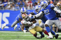 San Francisco 49ers running back Elijah Mitchell (25) is brought down by Detroit Lions cornerback Jeff Okudah (23) in the second half of an NFL football game in Detroit, Sunday, Sept. 12, 2021. (AP Photo/Lon Horwedel)